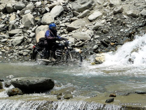 Himalaya: negotiating a water flow across the entire road