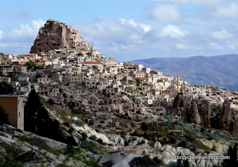 Town of Çavusin carved from the lava rock in Cappadocia