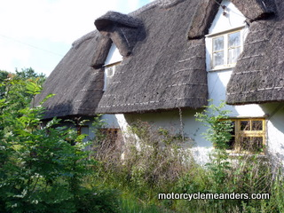 Old thatched roof duplex cottage on The Green